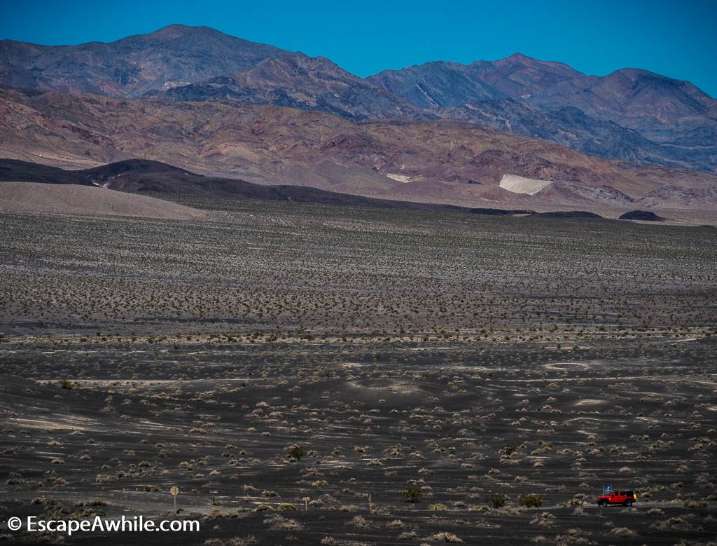 One of the bright red hire Jeeps turning off to the 25 mile 4WD-only track to Racecourse, Death Valley NP.