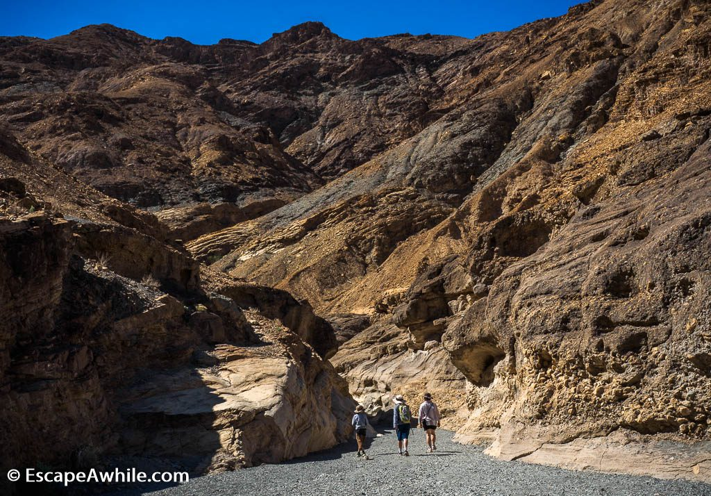 After the wide opening at the start of the walk, canyon narrows down. Mosaic Canyon, Death Valley NP.