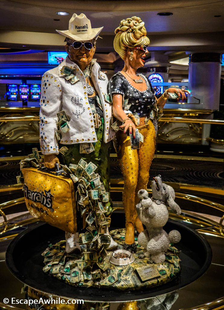 """The Greenbacks"" statue insige Harrahs Casino, Las Vegas. Next time you vistit Vegas, make sure you follow the dress code suggestion and pack your suitcase with only the important stuff."