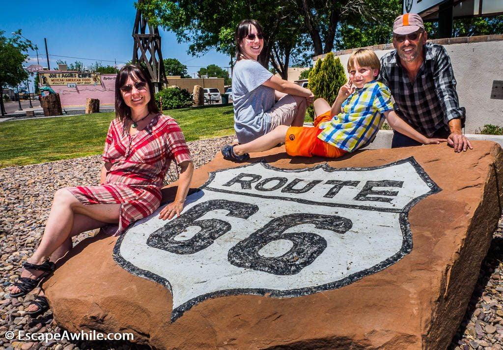 Family photo on historic Route 66 marker, Holbrook, Arizona, USA