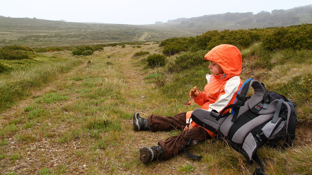 Tobiash resting and refueling energy with a muesli bar.